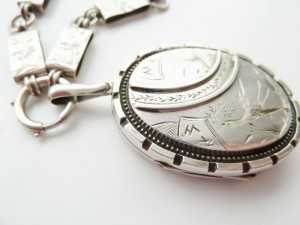 A Victorian Aesthetic Period Silver Locket & Chain